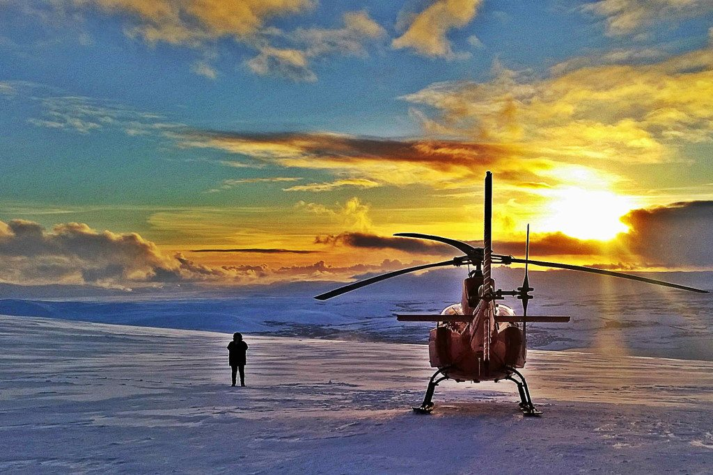 Our helicopter in the sunset on a nearby mountain summit on the Heli Romance tour