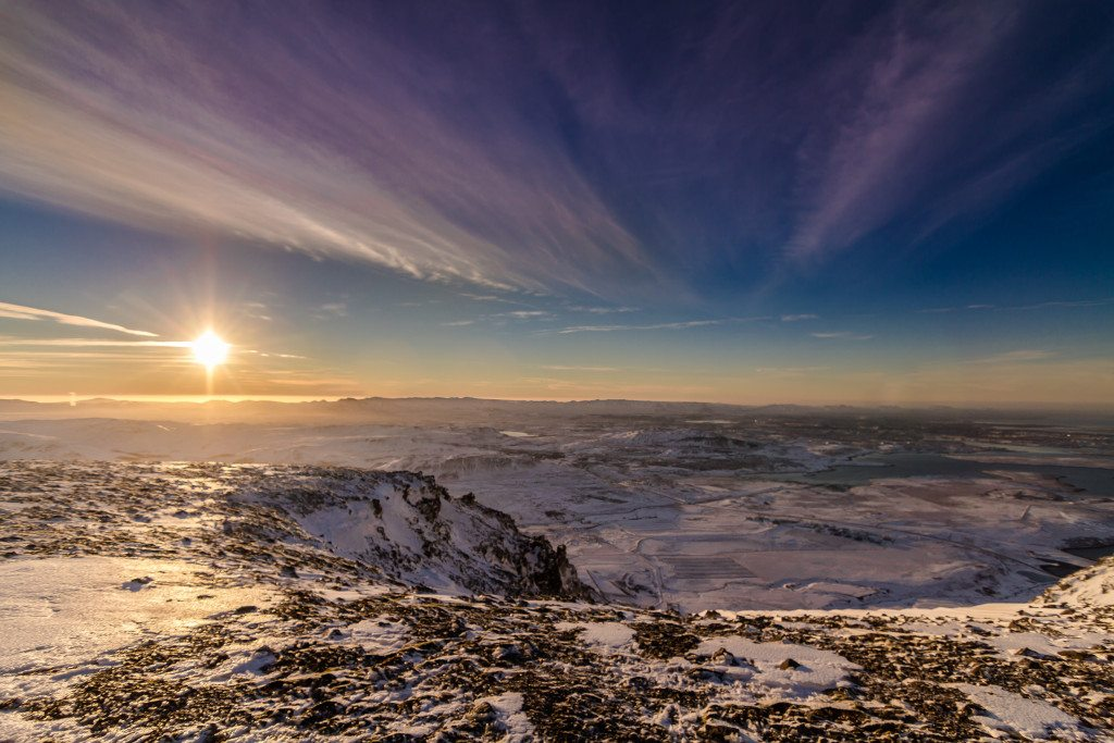 Sun setting over Reykjavik, as seen from a nearby mountain summit on the Reykjavik Summit tour