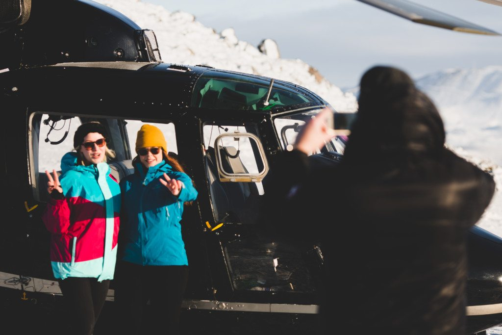 Taking a picture next to the helicopter on the Reykjavik Summit tour
