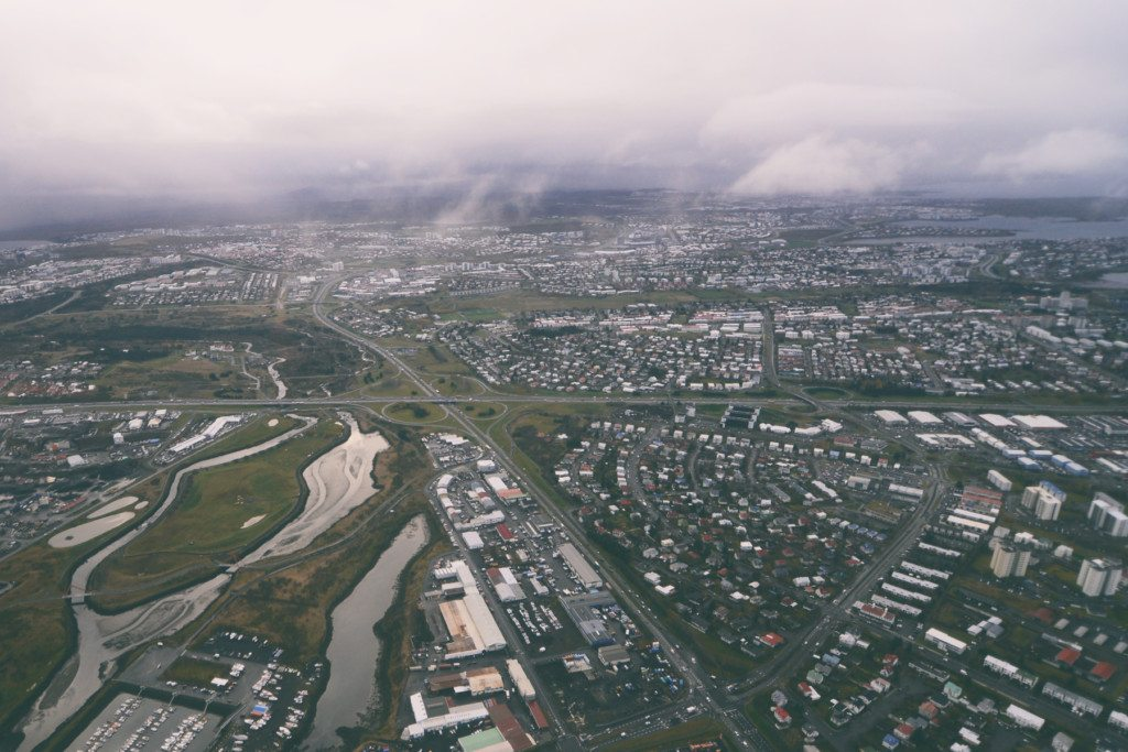 reykjavik and surroundings as seen from inside a helicopter