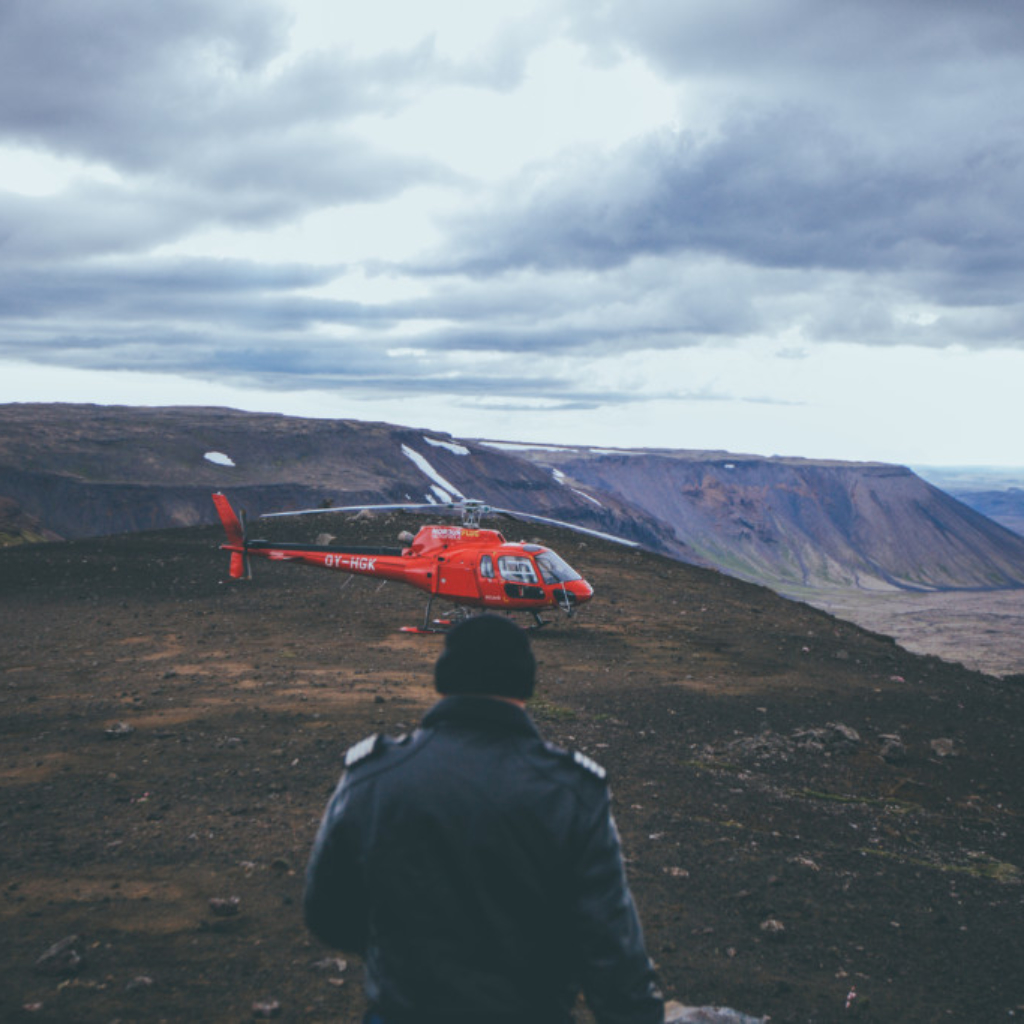 Our helicopter and pilot on one of the mountain summits near Reykjavik