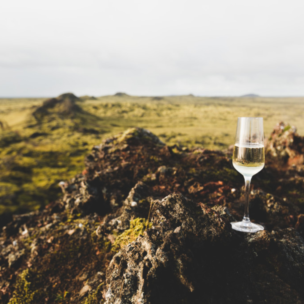 Enjoying a glass of sparkling wine on a Reykjavik summit on the Heli Happy Hour tour