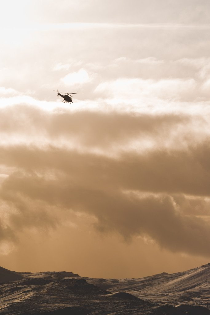 One of our helicopters flying through the dramatic Reykjavik sky.