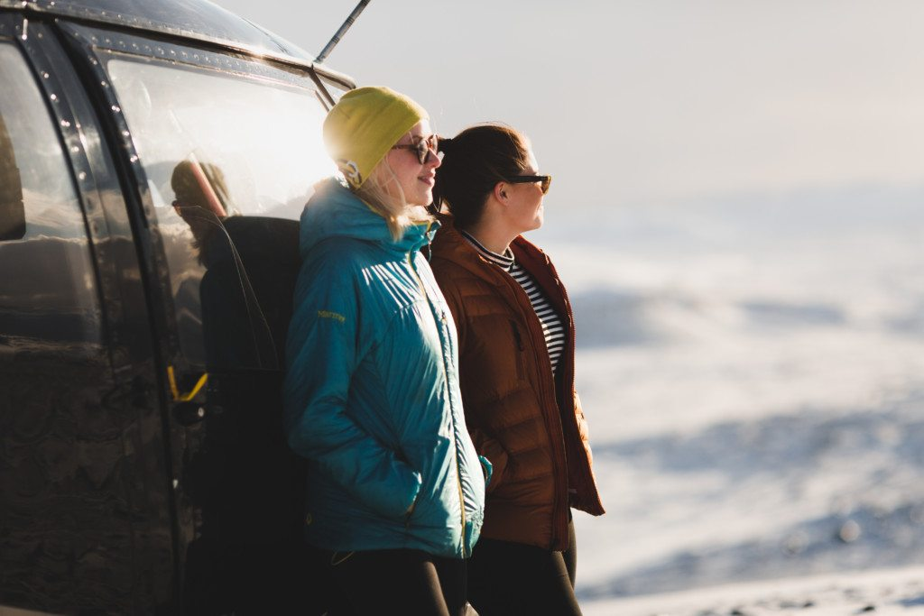 Happy helicopter passengers taking in the view on a Reykjavik summit tour.